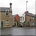 SK3447 : Belper: across the A6 on a wet morning by John Sutton