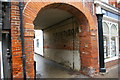 TM3877 : Thoroughfare, Halesworth: ghost-sign in archway by Christopher Hilton