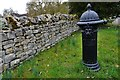 TL0258 : Bletsoe Village Water Pillar by Michael Garlick
