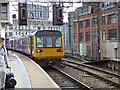 SJ8497 : Oxford Road station - train to Southport by Stephen Craven