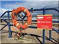 NU0051 : A Lifebelt hangs on the railings at Spittal Promenade by Jennifer Petrie