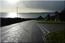 SX9463 : Dark skies over Ilsham Marine Drive by N Chadwick