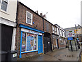 SE4843 : Shops with archway, High Street, Tadcaster by Stephen Craven