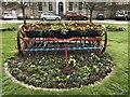 TL2471 : Old seed drill in flower - Huntingdon by Richard Humphrey