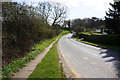SE3023 : Brandy Carr Road towards the A650 by Ian S