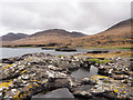 NM4936 : Rocks and rock pool at shore of Loch na Keal by Trevor Littlewood