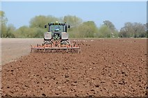 SO8451 : Tractor disc harrowing by Philip Halling