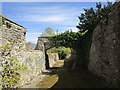 NZ1114 : Arch over the path to the church, Wycliffe by Jonathan Thacker