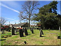 NZ1014 : The churchyard and rear of the Village Hall, Whorlton by Jonathan Thacker