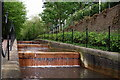 TQ3480 : Weir by Tobacco Dock by Peter Trimming