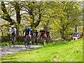 SD9772 : Tour de Yorkshire - spectator cyclists  by Stephen Craven