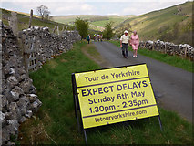 SD9772 : Sign warning of delays due to the Tour de Yorkshire by Stephen Craven