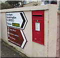 SX8960 : Queen Elizabeth II postbox and direction signs on a Paignton wall by Jaggery