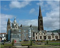 NS2059 : War Memorial and a glimpse of two churches by Gerald England