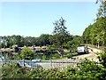 SE5033 : Fishing pond beside the railway by Graham Hogg