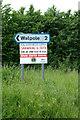 TM3976 : Roadsign on Grange Road by Geographer