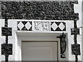 TM5593 : Above the doorway of the South Flint House by Adrian S Pye