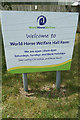 TL9990 : Welcome to World Horse Welfare Hall Farm sign by Adrian Cable