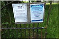 TL9991 : Notices on All Saints Church Gates by Adrian Cable