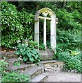 TG2208 : The Plantation Garden - church window beside the path by Evelyn Simak