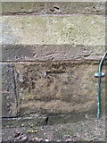 NZ8911 : Weathered bench mark on St Hilda's church, Whitby by John S Turner