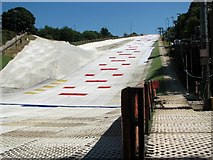 TG2407 : Dry ski slopes at the Trowse Snowsports Club by Evelyn Simak