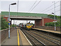TM0558 : Stowmarket: containers from Felixstowe by John Sutton