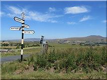 SD7266 : A fingerpost and Ingleborough by John S Turner
