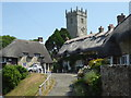 SZ5281 : Godshill - cottages and church by Chris Allen