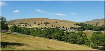 SD9772 : Kettlewell seen from the B6160 road from Grassington by Chris Wood