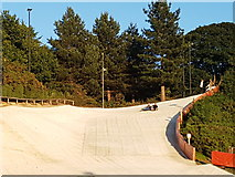 TG2407 : Dry ski slope at Trowse by Helen Steed