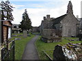 ST5190 : Path through St Peter's churchyard, St Pierre, Monmouthshire by Jaggery