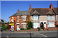 SP3380 : Off licence and houses at north end of Sandy Lane by Roger Templeman