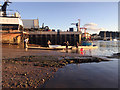 SX9372 : A rowing team bring their gig ashore by the New Fish Quay, Teignmouth by Robin Stott