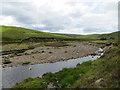 NC3813 : Small island formed on the Abhainn Gleann na Muic by John Ferguson