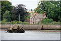 SX9782 : Starcross Lodge and a Wrecked Boat on the river Exe by David Dixon