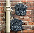 TG2308 : 41 Elm Hill - parish boundary markers by Evelyn Simak