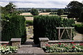 TQ3563 : Gardens at Heathfield by Peter Trimming