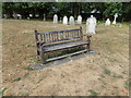 TL8628 : Seat in St. Andrew's Churchyard by Adrian Cable