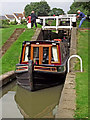 SP5968 : Narrowboat in the Watford staircase Locks, Northamptonshire by Roger  Kidd