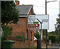 TL8628 : Roadsign on the A1124 Upper Holt Street by Geographer