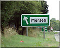 TL9525 : Mersea sign on the A12 London Road by Adrian Cable