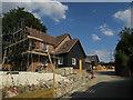 TL4038 : Houses under construction, Barley by Hugh Venables