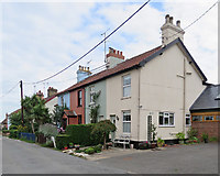 TM2844 : Waldringfield: colour-washed cottages by John Sutton