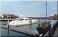 SU4310 : Large Boat and Flower Tub, Ocean Village by Des Blenkinsopp