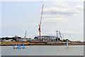 SU4310 : Sailing past the building site by Des Blenkinsopp