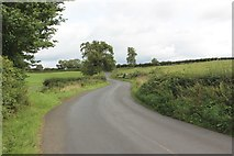 NU2304 : Morwick Road south of Warkworth by Graham Robson