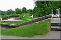 SP6989 : Footbridge and sideponds at Foxton Locks in Leicestershire by Roger  Kidd