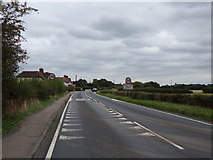 TL9326 : Entering Eight Ash Green on the A1124 Halstead Road by Adrian Cable