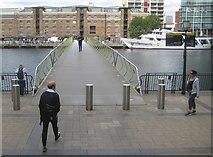 TQ3780 : Canary Wharf: West India Dock North Floating Footbridge by Nigel Cox